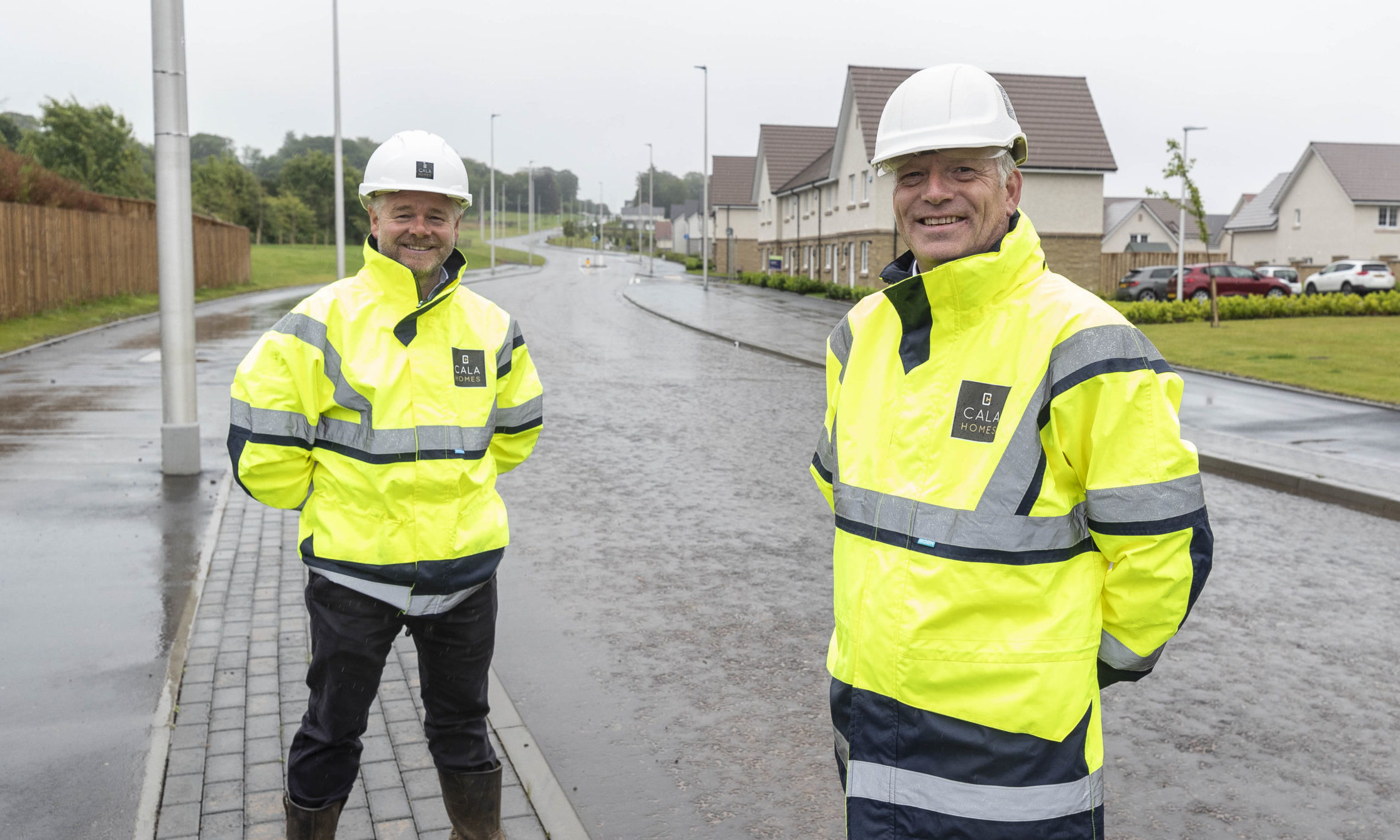 Cala Homes (North) construction director Stephen Jarvie and managing director Mike Naysmith on the newly-opened Craigbank Drive.