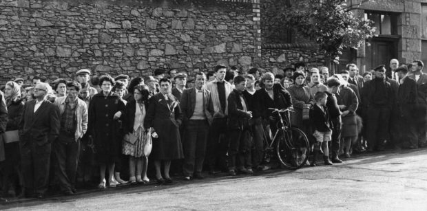 The crowd wait silently for the fateful moment outside Craiginches prison.