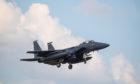 An F15 fighter jet landing at RAF Lakenheath, Suffolk. Joe Giddens/PA Wire