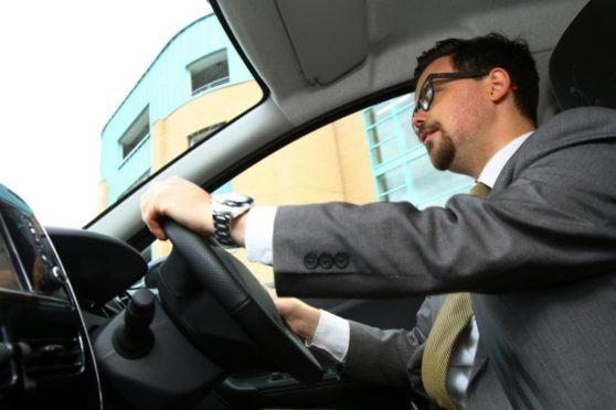 DC Thomson journalist Jon Brady at the wheel.
