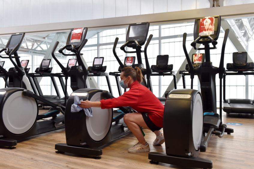 Tracey Stainer cleaning machines in the gym.  Picture by Kenny Elrick     28/08/2020