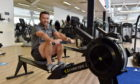 Chief executive of Aberdeen Sports Village, Duncan Sinclair, on the rowing machine.  Picture by Kenny Elrick     28/08/2020