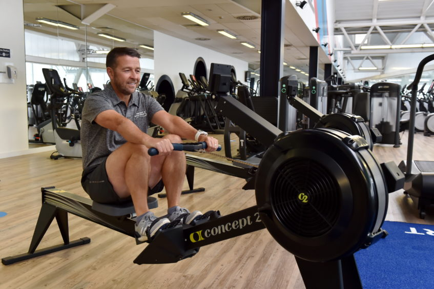 Duncan Sinclair on the rowing machine.   Picture by Kenny Elrick     28/08/2020