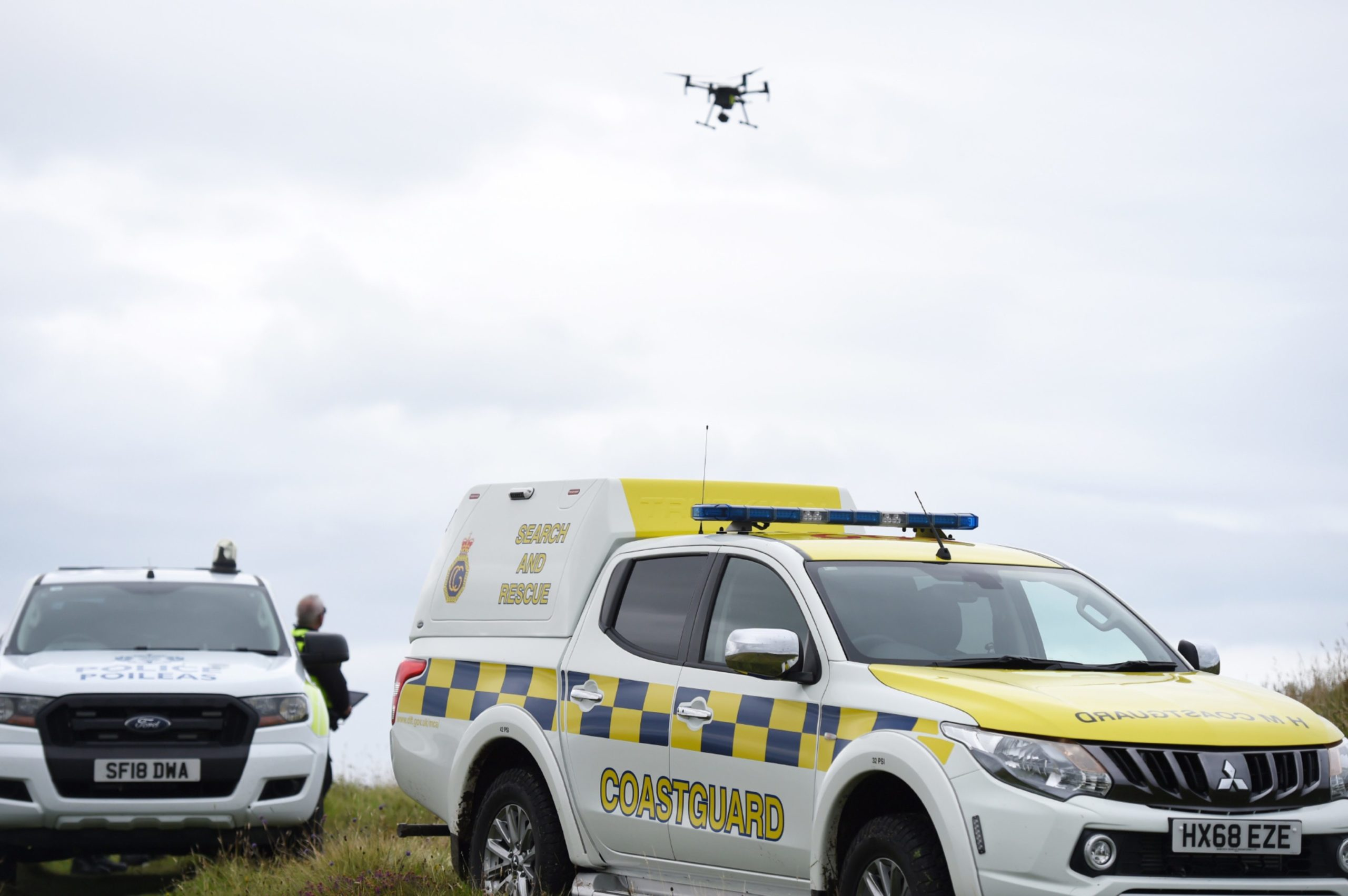 Police use a drone unit as search for a fallen climber continues.