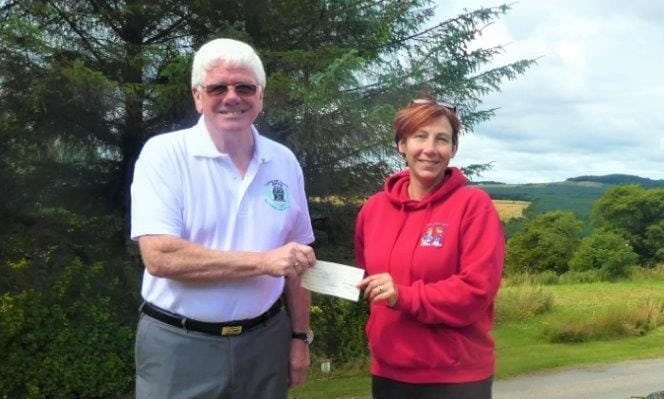 Ron Fowler, provincial grand master of the Freemasons of Moray and Nairn hands over cheque to Moray School Bank's Debbie Kelly.