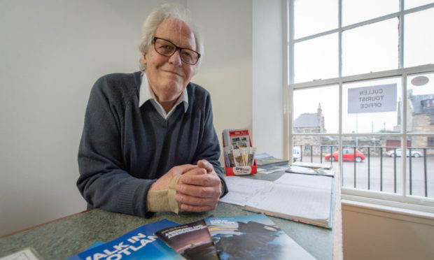 Graham Bell, secretary of Cullen Voluntary Tourist Initiative, inside the Tourist Information office in Cullen.