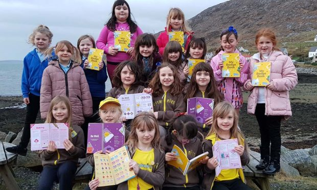 Isle of Harris Brownies with their new badge books, funded by The Scottish Salmon Company