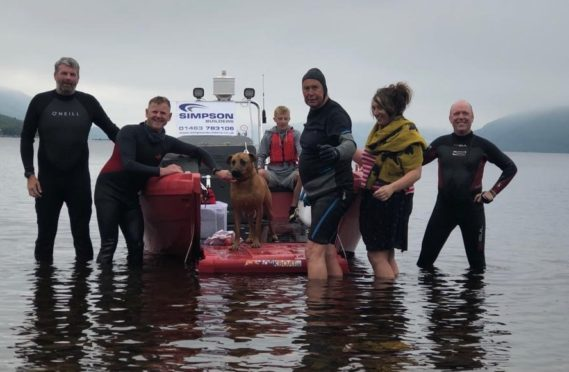 From left to right; Andrew Phillips, Gordon Simpson, Suli the dog, Alastair MacGregor, Aileen-Anne and Mark McCann