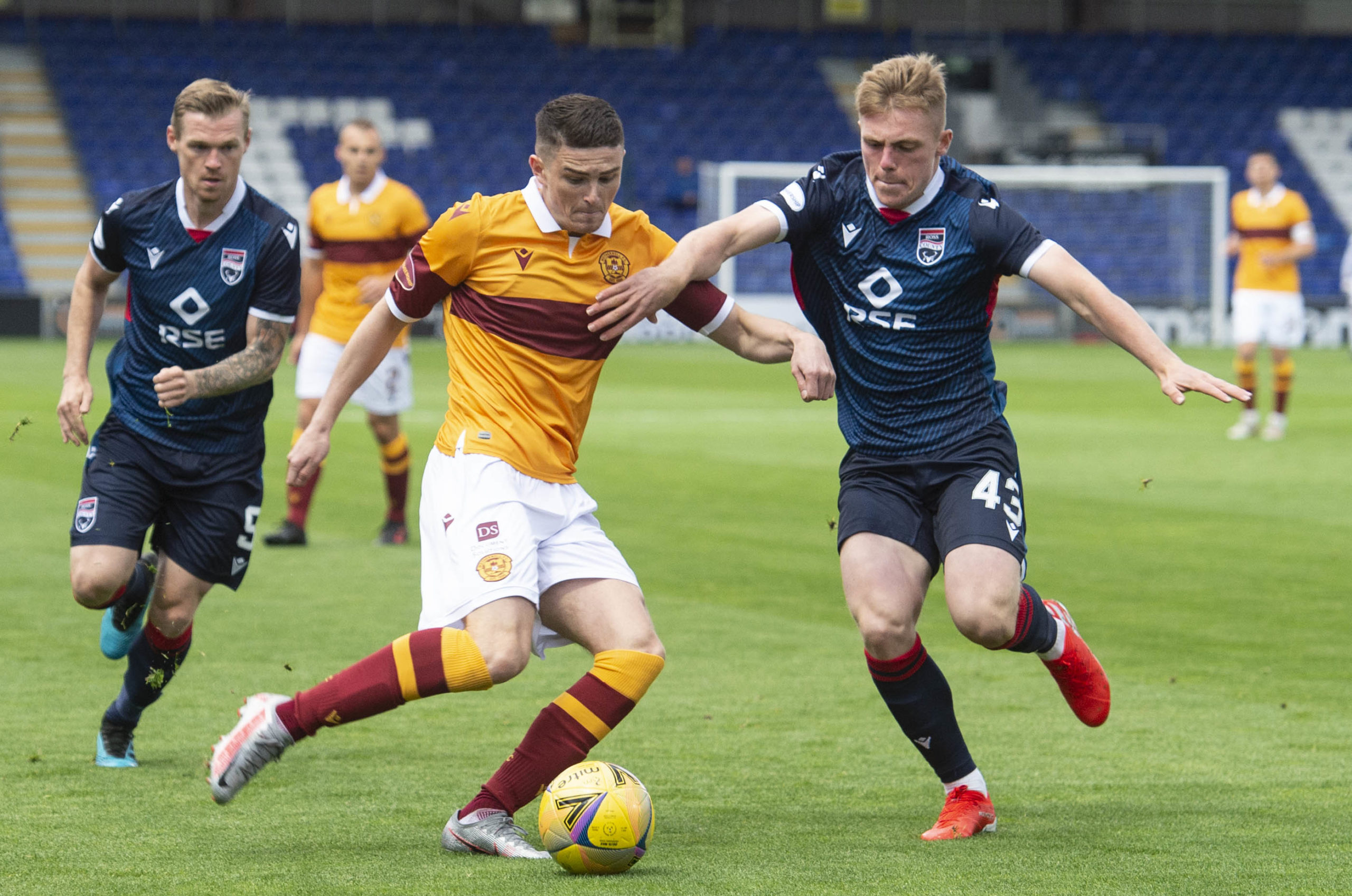Ross County defender Josh Reid (right) has impressed in his early appearances