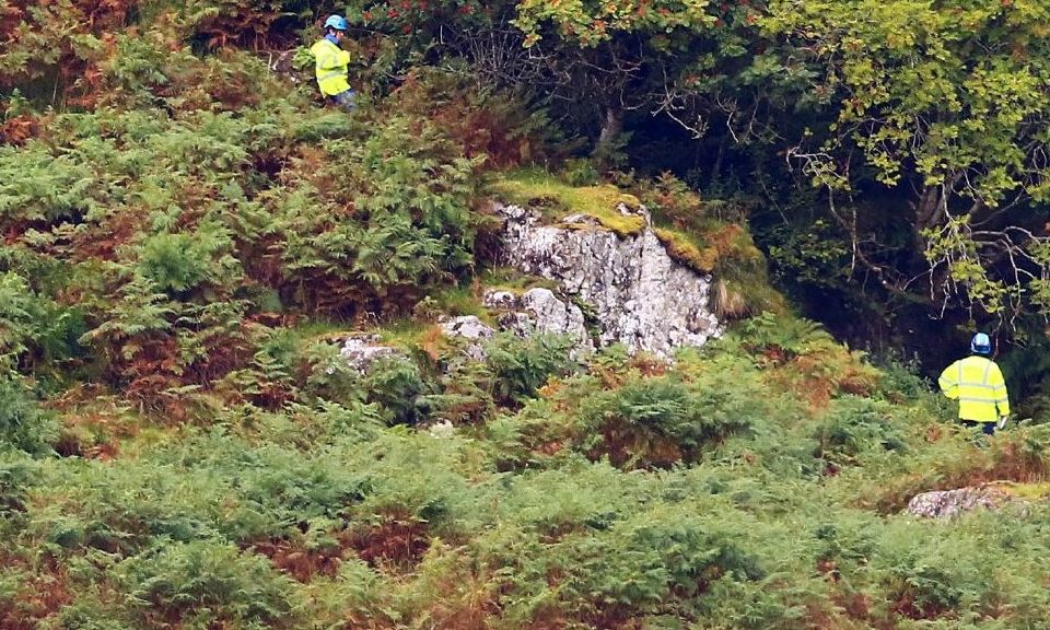 Members of Oban coastguard rescue team search for the missing vulnerable lady on the hill above the mouth of loch feochan