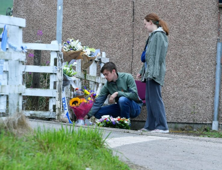 Small ceremony and flowers being laid by the public at Carmont signal box.