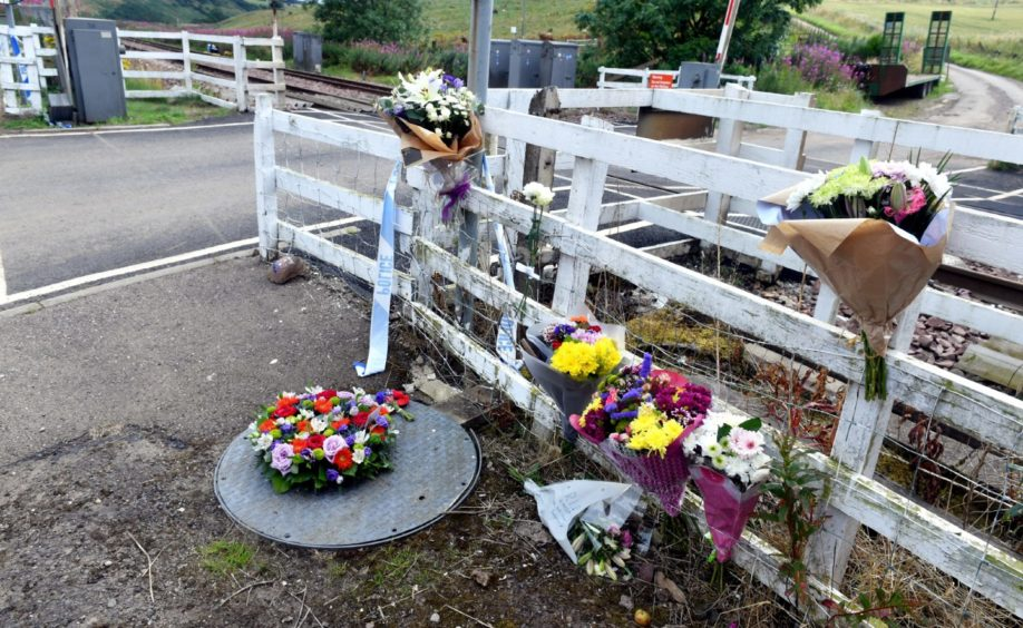 Flowers and tributes by Carmont signal box.