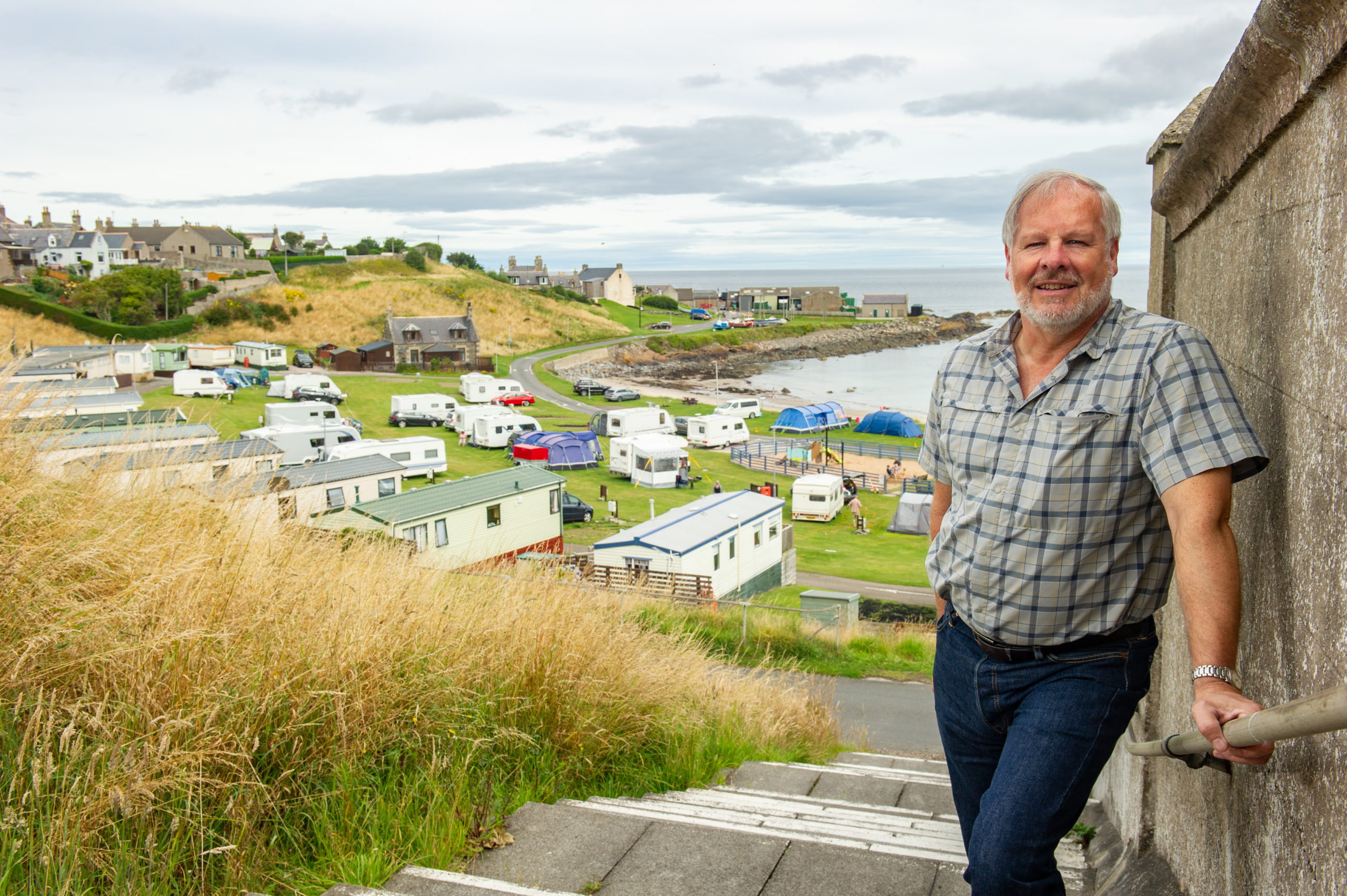 Pictures by JASON HEDGES     05.08.2020 - Councillor John Cox at Portsoy over looking a campsite from the viewpoint at Aird Green. Picture by Jason Hedges