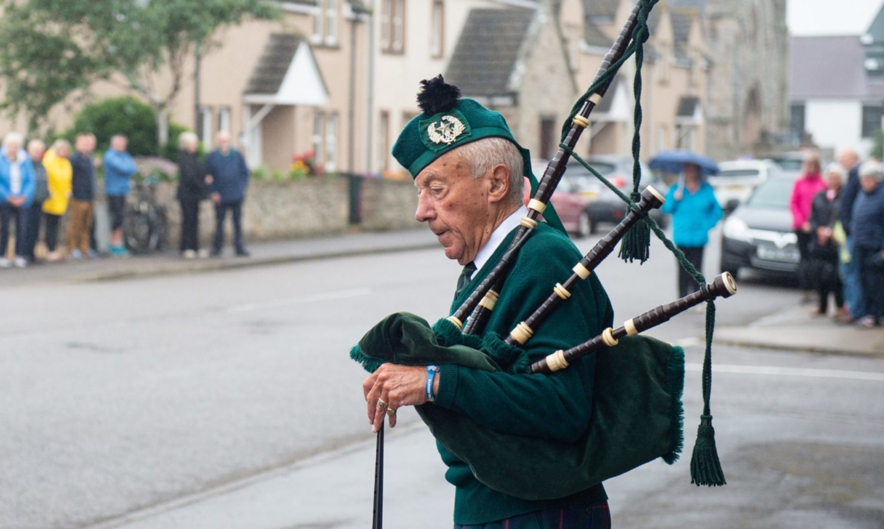 Beadle piper Patrick Glendinning pipes outside Burghead's Church of Scotland in tribute to Christopher Stuchbury, who died in the Stonehaven train crash. Pictures by Jason Hedges.