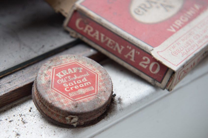 Secret messages, chocolate bar wrappers and cigarette packets were found under the floorboards. Pictures by Jason Hedges.