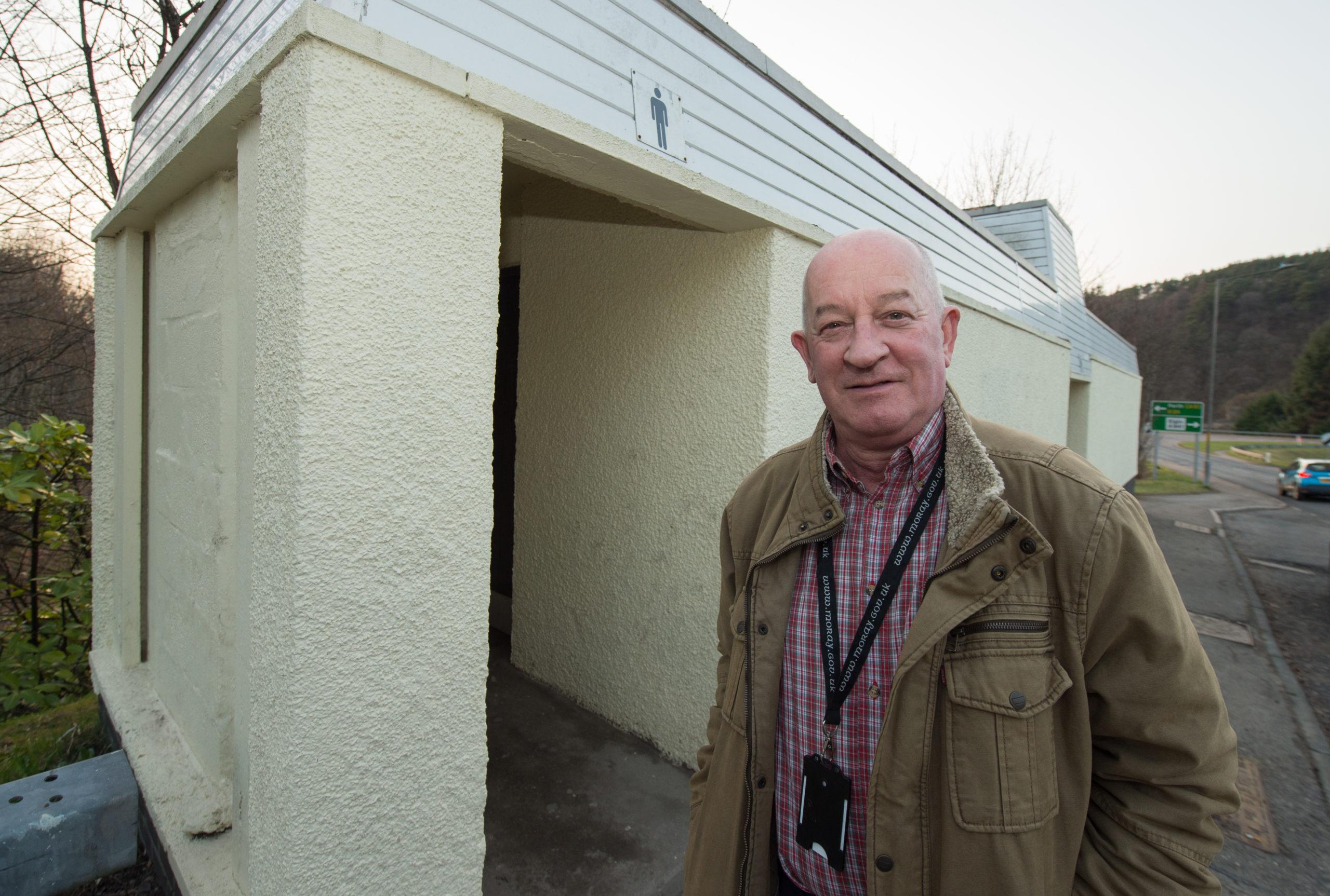 Councillor Derek Ross outside public toilets in Craigellachie.
