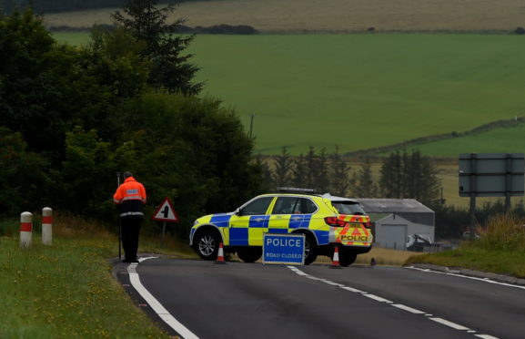 Police at the scene of the incident on the A96 south of Keith.
