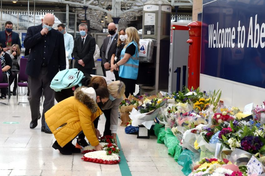 Aberdeen Railway Station fell silent at 9.43am. Family members were seen laying wreaths and floral tributes. Picture by Kenny Elrick