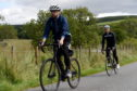P&J reporter Jon Brady (front) on his first bike ride.