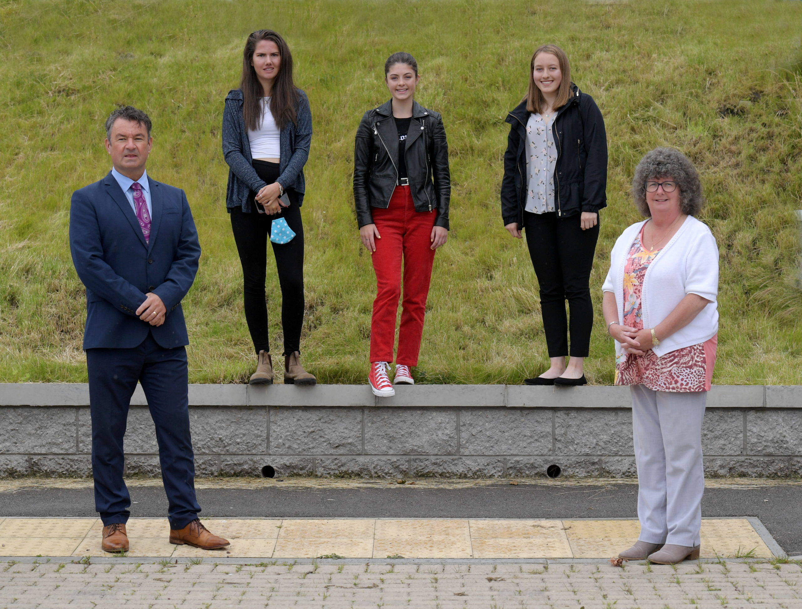 Pictured from left, Head of Education Vincent Docherty, students Megan Kelly, Abbie Johnson, Amy Simpson and councillor Gillian Owen. Picture by KATH FLANNERY