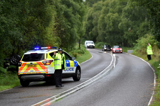 A woman has been taken to hospital following a one-vehicle crash