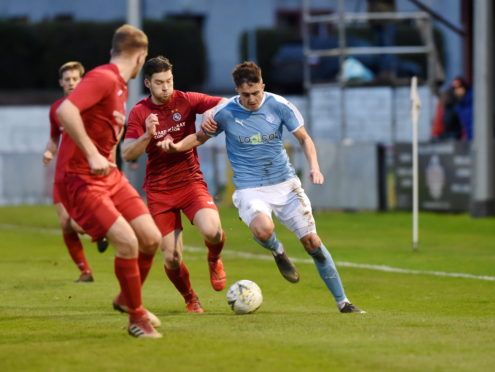 Scott Davidson of Nairn in action against Brora
