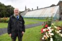 CLLR GLEN REYNOLDS AT THE VINERY AND GARDENS IN BANFF.
