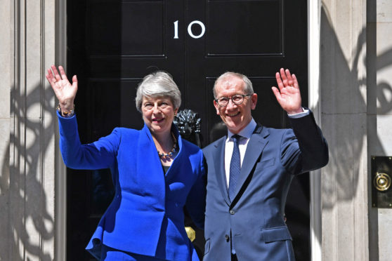 Outgoing Prime Minister Theresa May with husband Philip outside 10 Downing Street prior to handing in her resignation to the Queen at Buckingham Palace. Philip has been made a peer by Boris Johnson. And for what? Putting out the bins while his wife ran the country?