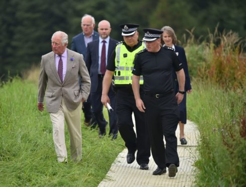The Duke of Rothesay during a visit to the train crash site at Stonehaven.
