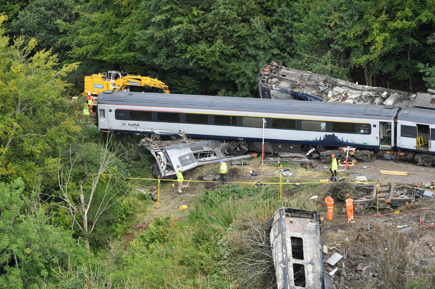 A crane is brought in to the scene near Stonehaven, Aberdeenshire, following the derailment of the ScotRail train.