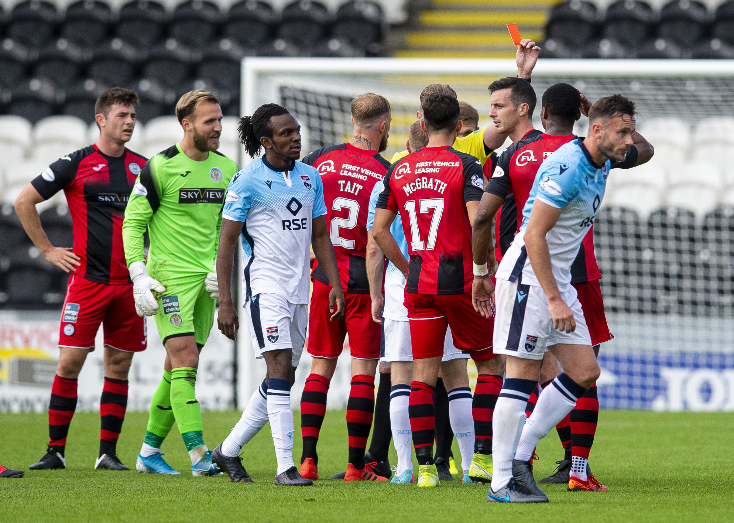 St Mirren's Joe Shaugnessy  (R) is shown red after a challenge on Ross County's Ross Stewart during the Scottish Premiership match between St Mirren and Ross County at St Mirren Park.