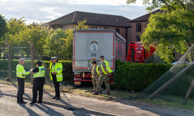 The lorry crashed through a fence at Kinloss Army Barracks
