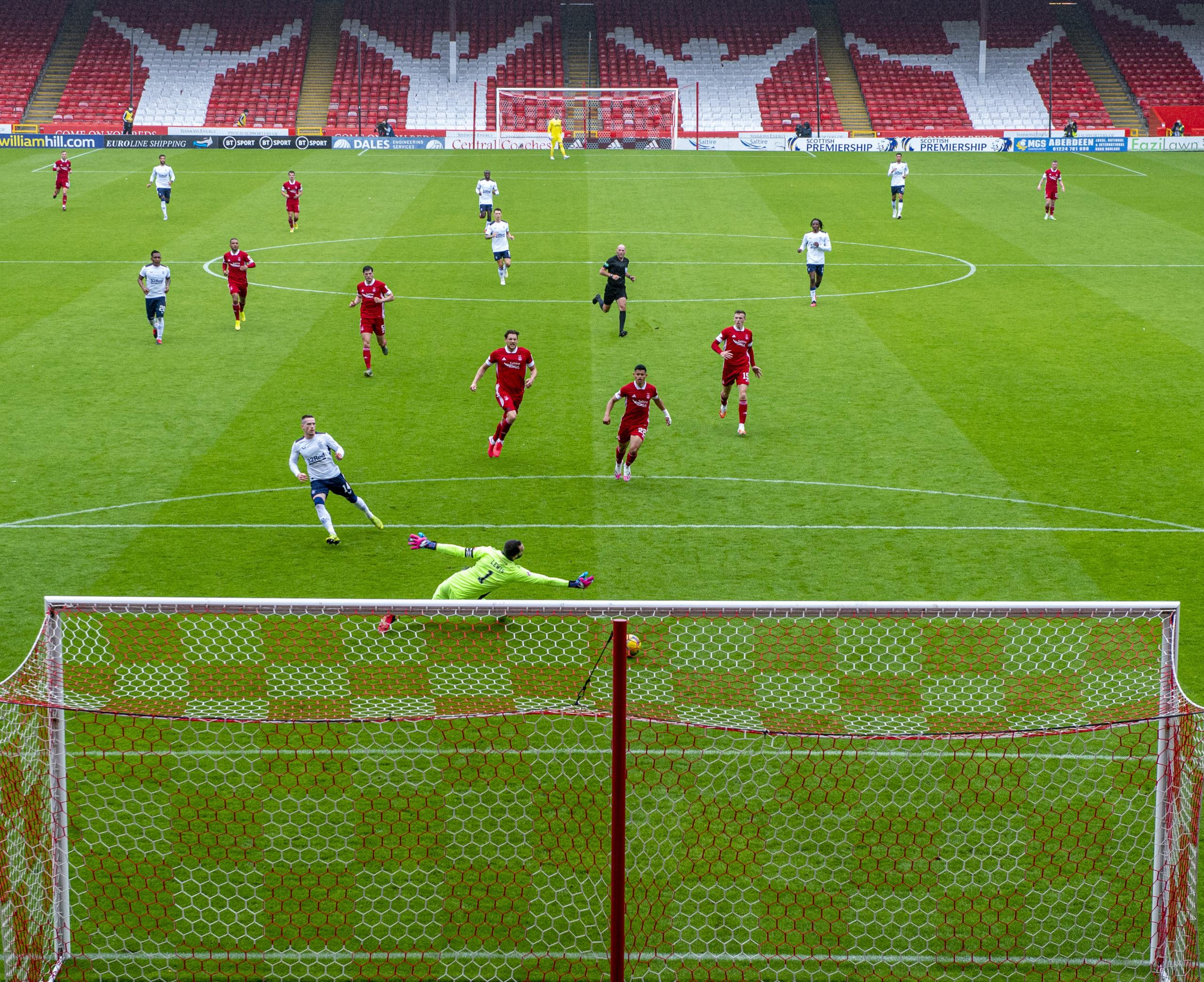 Ryan Kent slots Rangers' winner past Aberdeen keeper Joe Lewis on the opening day of the Premiership campaign.