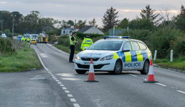 Police at the scene of the accident on October 4.