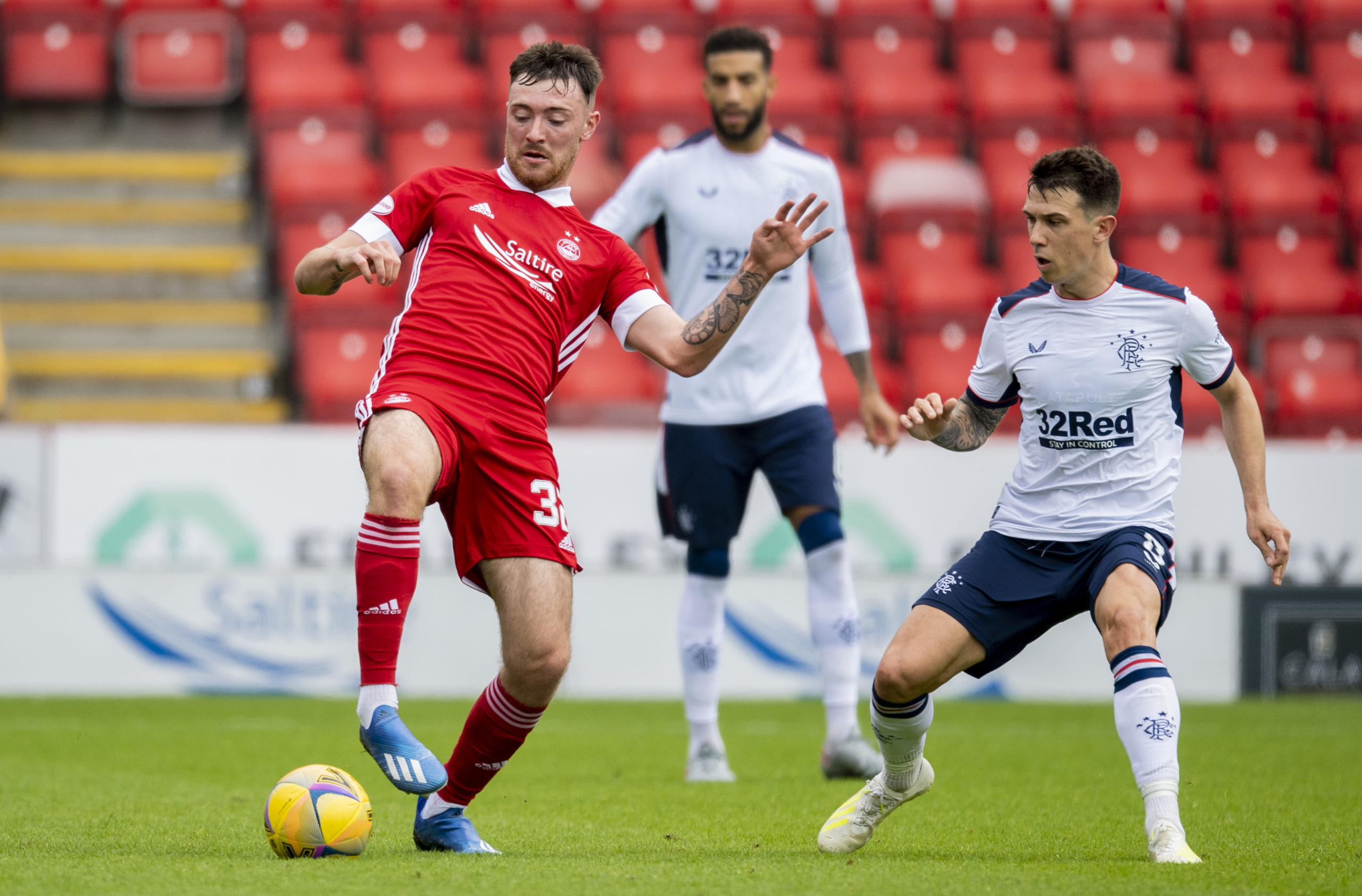 Ryan Edmondson holds off Rangers' Ryan Jack.