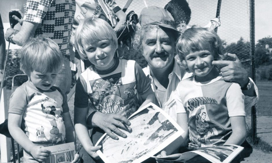 Film star Bernard Cribbins signs autographs for Cults brothers Anthony, David and Sasha Gudd at the Aberdeen Petroleum Club Pro-Cel-Am tournament in aid of SPARKS (Sport Aiding medical Research for Kids) at Deeside Golf Club in 1977.