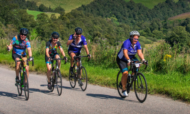 Participants in Ride the North in 2019 enjoy a fine day's cycling.