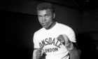 Cassius Clay, in training prior to defending his world heavyweight championship title against Henry Cooper in London.