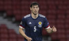 Or will former Dons team-mate Scott McKenna, pictured, and Kieran Tierney being fit see him drop to the bench?