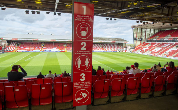 Supporters were permitted back to Pittodrie for a test event in September.