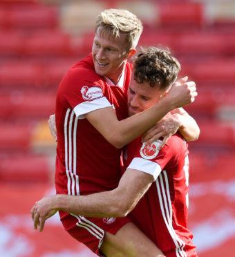 Aberdeen's Ross McCrorie (L) celebrates making it 1-0 with Marley Watkins