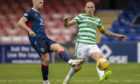 Ross County's Iain Vigurs (left) holds off Celtic's Scott Brown during their Scottish Premiership match
