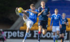 St Johnstone's David Wotherspoon (L) and Ross County's Ross Stewart during the Scottish Premiership match between St Johnstone and Ross County at McDiarmid Park.