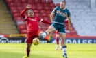 Aberdeen's Funso-King Ojo and Motherwell's Allan Campbell in action during a Scottish Premiership match.