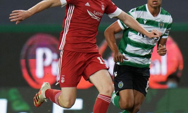 Aberdeen's Lewis Ferguson (left) holds off Sporting's Matheus Nunes