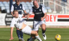 Harry Milne challenges Charlie Adam during Cove Rangers' pre-season friendly with Dundee.