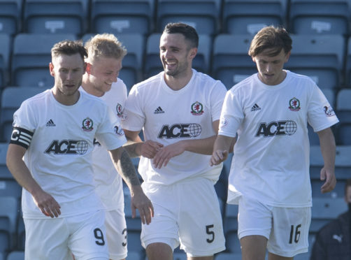 Cove Rangers players celebrate Scott Ross' opening goal against Dundee.