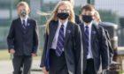 School pupils wear masks to classes.