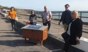 L-R: Mairi Gougeon MSP, Aberdeenshire Councillors Sarah Dickinson and Brian Topping, Turning the Plastic Tide project manager Crawford Paris, and Janice Langdon, owner of Molly's Cafe Bar in Stonehaven.