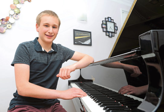 Pianist Aaron Magill, 16, who recently performed alongside the Scottish Orchestra (via zoom) after he composed some music for a song about mental health and coronavirus.  Picture by Darrell Benns